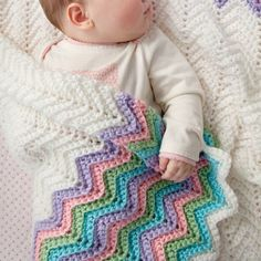 The Rickrack Rainbow Ripple Baby Blanket is available from Yarnspirations. You will need Medium Weight Yarn [4] and a 5.5 mm (I) hook for this project. The finished blanket measures 36 inches X 36 inches.
