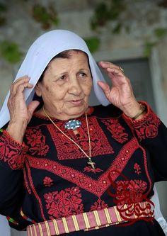 Palestinian Christian woman in traditional embroidery; photo Osama Silwadi