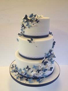 Wedding cake butterflies!! possibly add a coral color.