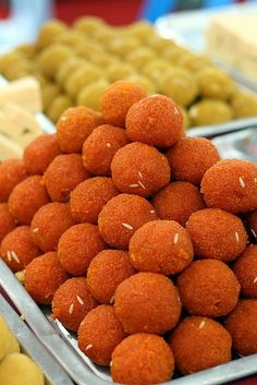 Laddu or Laddoo is a ball-shaped sweet  made of flour and sugar with other ingredients that vary by recipe. Very popular in Trinidad and Tobago.