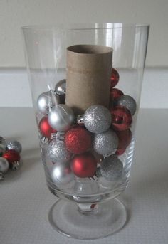Use a Toilet Paper Roll as a Vase Filler - 12 Brilliant DIY Christmas Centerpiece Ideas | GleamItUp