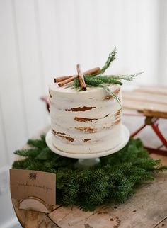 Petite Wedding Cake Topped with Cinnamon Sticks | Jacque Lynn Photography and Michelle Leo Events | Enchanting Woodland Wedding Shoot with Rustic Winter Details