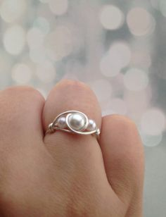 This is a wire wrapped ring with varying sizes of pearls. The ring is made from silver plated wire and should be tarnish free. The simple but beautiful design great for any occasion and can be made to fit anyones finger. Sizes available for this ring are US sizes 4-16 It is possible for me to make sizes slightly smaller than a 4. Please leave a message and I will do my best to size the ring exactly how you need. *FREE SHIPPING* If two or more items are purchased free shipping will be…