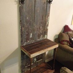 Hall tree made from old door and reclaimed wood.