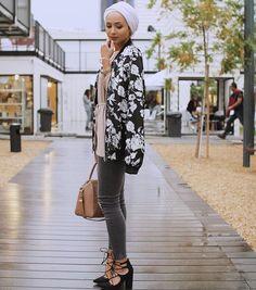 Maria Alia | black and white floral jacket + pale pink powder baby shirtdress shirt + gray skinny jeans + black chunky lace-up pointed toe heels + tan handbag + white turban scarf/hijab