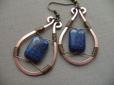 Copper and brass wire wrapped earrings in a classic teardrop shape with dark blue Lapis Lazuli stone beads.  2 inches long including the ear hook