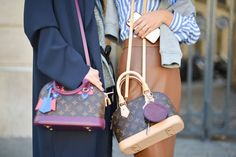 Pin for Later: Proof the Prettiest Street Style Accessories Were at Paris Fashion Week Day 3 Louis Vuitton bags.