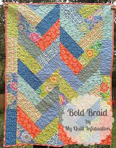 My Quilt Infatuation: Bold Braid Quilt..I love the look of braid quilts and herringbone quilts, but when I'm short on time, I don't want to fuss with all of those tiny strips.  By making the strips wider, you can create a quilt with big impact in a snap!  Here's how-Your finished quilt will measure 40 x 52 inches.  That's a great size for a baby or child, or even a large table topper!