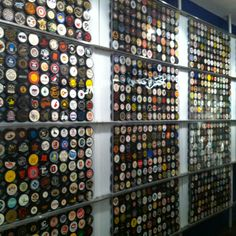 At Hockey hall of fame. A hundred of hockey pucks are displayed.