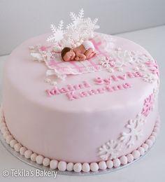 snowflakes cake with fondant baby. #tekilasbakery http://www.tekila.fi/lumihiutalekakku-tytolle/
