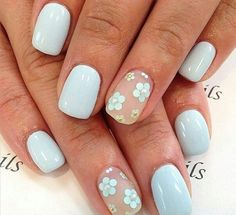 Light blue nails with little flowers - LadyStyle