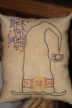 Black Hat Society_ big energy with so few stitches. Halloween Pillows, Halloween Quilts, Fall Halloween, Primitive Embroidery, Primitive Stitchery, Halloween Embroidery, Halloween Cross Stitches, Cross Stitch Embroidery, Embroidery Patterns