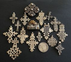 Africa | Collection of Ethiopian coptic crosses (with the exception of two) and a brooch in the form of a typical Nubian houses in Upper Egypt | Purchased in Egypt about 25 yrs ago | ©Jose M Pery