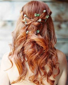 Pretty Wedding Hairstyles for Your Bridesmaids | Martha Stewart Weddings - Instead of a flower crown, try inserting stems into an intricate and ethereal braided look.