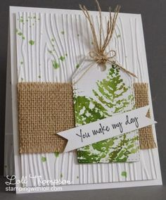 handmade card from Stamping with Loll ... luv the textures on this card ... woodgrain embossing folder on background ... rough woven burlap ribbon ... stringy tie on the tag ... water color fern and green splats ... great card for a male ... or anyone who loves nature ...