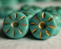 Turquoise Gold Picasso Czech Glass Bead 12mm Daisy Flower :  10 pc by BobbiThisnThat on Etsy https://www.etsy.com/listing/185358836/turquoise-gold-picasso-czech-glass-bead