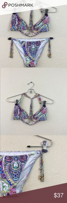 Victoria's Secret bikini • Victoria's Secret • Bikini with beading • Top has no padding but has option to add and is a size medium • Bottom is a size small • Easy used very clean Victoria's Secret Swim Bikinis