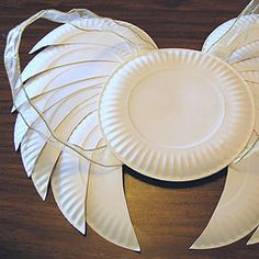 Angel wings made from paper plates and ribbon.