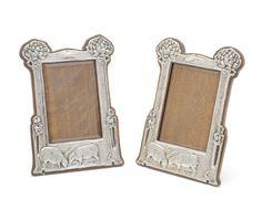 A pair of Art Nouveau silver photograph frames by Walker & Hall, Birmingham 1905....Bonhams