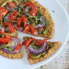 Mung Bean Sprout and Spinach Crust Pizza topped with Red onion, green bell pepper, tomatoes, garam masala. glutenfree vegan recipe