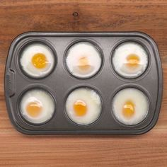Did you know that you can make poached eggs in a muffin tin? We'll show you how to save time and poach a dozen eggs at once in the oven. in oven How to Make Poached Eggs in a Muffin Tin Eggs In Muffin Tin, Muffin Tin Recipes, Egg Recipes, Cooking Recipes, Cooking Eggs, Muffin Pans, Cooking Ideas, Recipies, Dessert Recipes