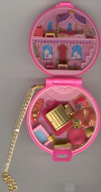 Polly Pocket~ I had this exact one- Polly looked like Princess Jasmine! My sister got it for my birthday!