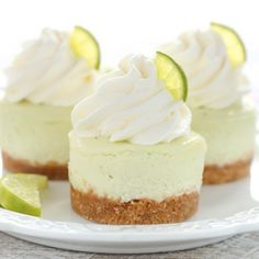 These Mini Key Lime Cheesecakes feature an easy homemade graham cracker crust topped with a smooth and creamy key lime cheesecake filling!