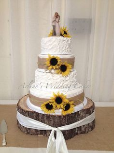 Love the feel of this country buttercream cake accented with burlap and sunflowers!