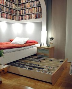 If your favorite activity in bed is watching movies, why keep your DVD collection in the living room? Store 'em under your bed in a pull-out drawer the size of your mattress. Then tuck it away and out of sight after you make your selection. See more at Apartment Therapy »