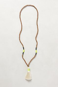 Rambla Tassel Necklace #anthropologie  Wood beads, 2 types of other beads, one type of accent beads. all could be wood and then painted, or use different mediums. End with a tassle