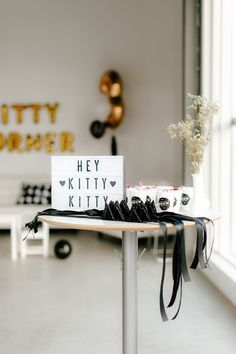 DIY Kitty Cat ears and lightbox welcome sign for guests at Black, White and Gold Kitty Cat Themed Girl's Birthday Party  More DIY's and details on www.creativewifeandjoyfulworker.com