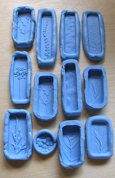 Molds by UnaOdd-Lynn.  Used a product called Knead-a-Mold, from Townsend Atelier. It creates a silicone rubber mold that sets in less than 10 minutes. The final mold can be used in the oven (for polymer) and is food safe as well. Polymer clay can be used in the molds.  Most molds were made from plants in the garden.