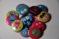 25 Happy Monster Flat Back Buttons. $7.00, via Etsy.