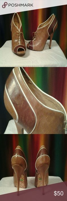 """L.a.m.b Heels Caramel brown, dark brown & white piped leather open toed lace up high heel. Some marks on leather ( can be seen in photos 2 & 4 ), wear @ soles, inner sole good condition. Concealed 1"""" platform w/ 5 in heel. L.A.M.B. Shoes Heels"""