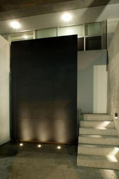 Black Concrete Wall Design In Stair Home contemporary modern house plans architecture with concrete material Home design http://seekayem.com