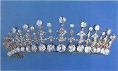 A Greek diamond tiara, sadly no longer with the family. Designed as a base with large circular diamonds, with diamond pinnacles and spacers rising from it. For its history see next pin.