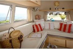 GLAMPING~Airstream with L shaped couch and storage beneath. Airstream Vintage, Airstream Campers, Airstream Remodel, Vintage Caravans, Camper Renovation, Vintage Travel Trailers, Remodeled Campers, Airstream Bambi, Vintage Campers
