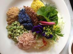 """Traditional Southern style Thai rice salad with fresh herbs, vegetables and flowers. It is called """" Khao Yum Samunprai"""""""