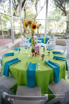 Texas Discovery Gardens Colorful Mexican Themed Wedding Reception Decor Using Blue And Green With Sunflower Centerpieces
