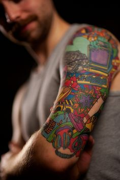 colorful collage sleeve! jam pack with all the best pieces from a life time, cool idea for an ever expanding tattoo.