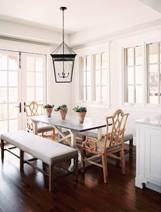casual + traditional.  natural light, bench seating, lantern pendant, and fretwork chairs | sasha adler & lauren gold