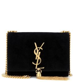 Saint Laurent - Classic Small Monogram suede shoulder bag - Featuring a golden chain strap, tassel and signature YSL logo, the Classic Monogram shoulder bag embodies the oh-so covetable Saint Laurent aesthetic. This black suede style is a refined finishing touch to an evening ensemble with its compact size and glamorous colour palette. Carry yours over your shoulder for an effortless look. seen @ www.mytheresa.com