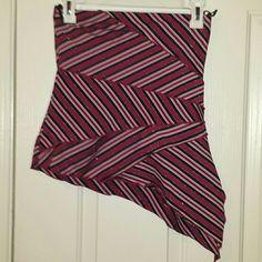 Shiny mini skirt Shiny red patterned mini skirt with asymmetrical hem. No size. I'd guess medium / small. Very stretchy though! Kiwi Skirts Mini