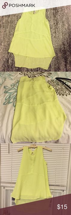 Bright Neon Top So cute but shirt is too small for my chest ::womp womp:: was only able to wear once. Perfect condition. Has a high low look with a button clasp on the back RACHEL Rachel Roy Tops Tank Tops