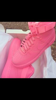 "There are 2 tips to buy these shoes. -- This is the Nike Air Force 1 High. While I'm not sure which release these were part of, you can create your own single color Nike Air Force 1 low or high model on nike.com. Just go to their ""customize"" section, select the Air Forces you want and design away! They offer ""hyper pink"", which may or may not be the color in your photo."