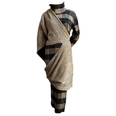 very early 1980's ISSEY MIYAKE black and tan ensemble  Japan    Very unique, incredibly rare dress and overlayer from Issey Miyake dating to the early 1980's. Black semi-knit fabric with tan woven underneath. Very soft and stretchy. Labeled a size '8', although this ensemble fits a size 4-12 due to stretch. Silk and cotton blend. Made in Japan. Very good condition.