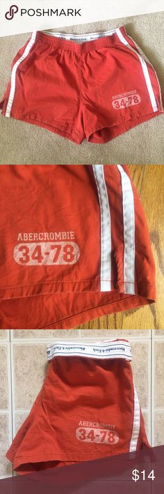 "Abercrombie Shorts Burnt orange Abercrombie & Fitch shorts with white stripes. Elastic waist band and a back pocket. 12 1/2"" waist, 3"" inseam, 11 1/2"" our seam. 100% cotton. EUC. ❌NO trades ❌NO lowballing Reasonable offers Abercrombie & Fitch Shorts"