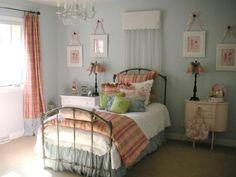This is about the right color blue. Interesting how pink and orange are used. Is that a shimmery silver bed skirt?