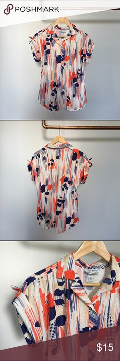 Vintage Floral Print Blouse Adorable vintage Elsa Phillips blouse with epaulets. Made in the USA. 100% Polyester. No buttons missing and in perfect condition! Could be dressed up for work or thrown on over a swimsuit for an easy summer look. Vintage Tops Blouses