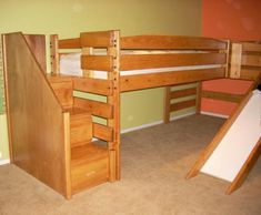 How unique and fun is this? A bunk loft bed with stairs with drawers in them and a slide!